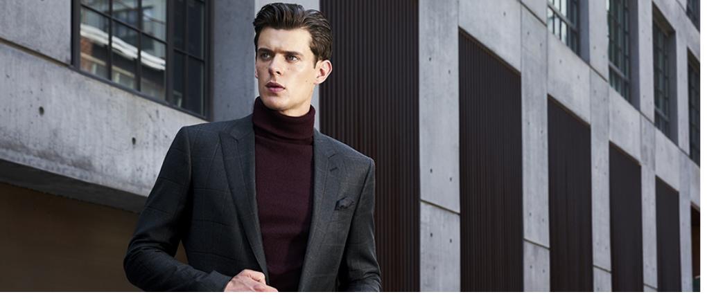 Hombre con suéter y traje